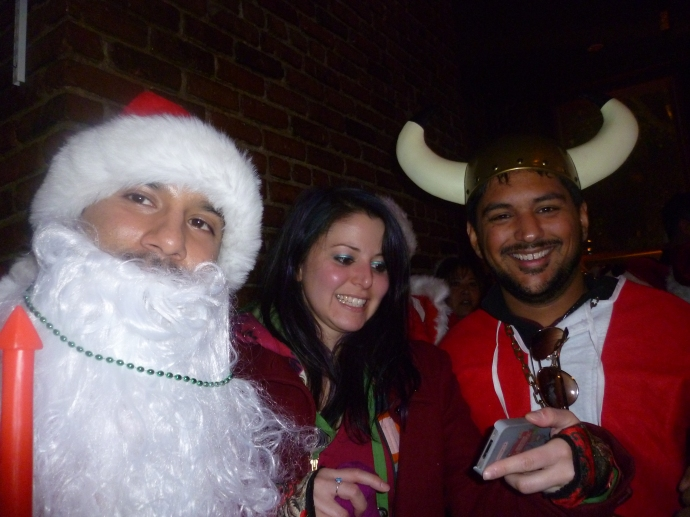 Some of the Santaconners who ended up at karaoke.  Is that a Viking Santa on the right?