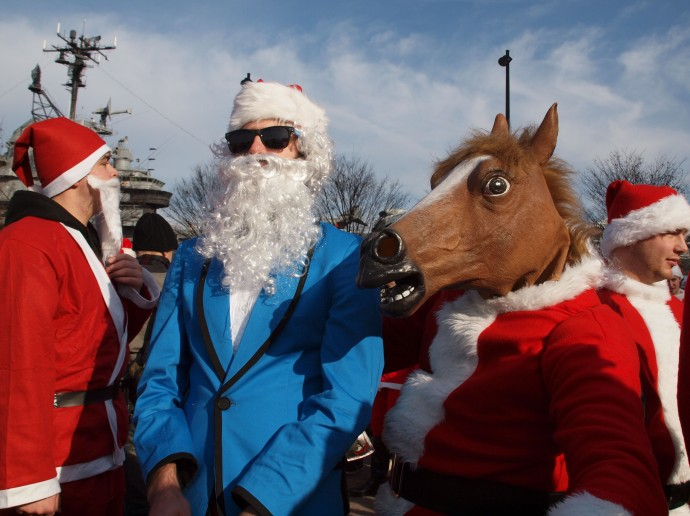 One of the strangest sights at this year's Santacon was a Santa with a horse's head.