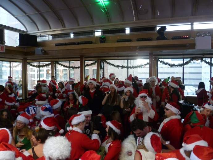 Santas partying on one of the very crowded dance floors in the Hudson Terrace nightclub -- at about noon.