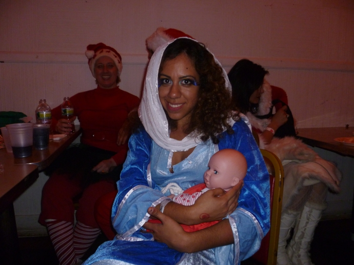 It's the Virgin Mary as a single mother! Joseph was nowhere to be seen.