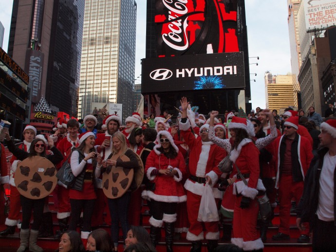 Santas on the TKTS steps in Times Square, along with some tourists who annoyingly insisted on crowding into the frame.
