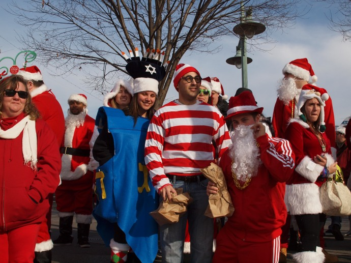 I found Waldo! Next to him is a dreidel, representing the many Santacon costumes that celebrate Hanukkah.