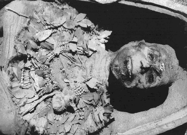 A postcard of King Tut's mummy from inside his tomb at the Valley of the Kings.