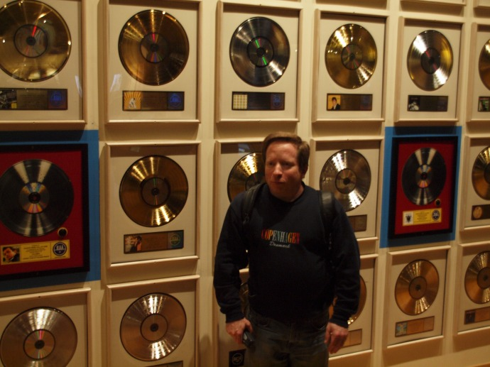 Me in front of some gold records in the Country Music Hall of Fame and Museum.