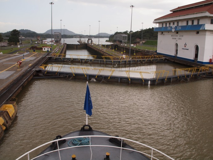 The view from a boat approaching one of the locks of the Panama Canal.