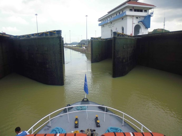 My view from a boat passing through the Miraflores Locks in the Panama Canal.