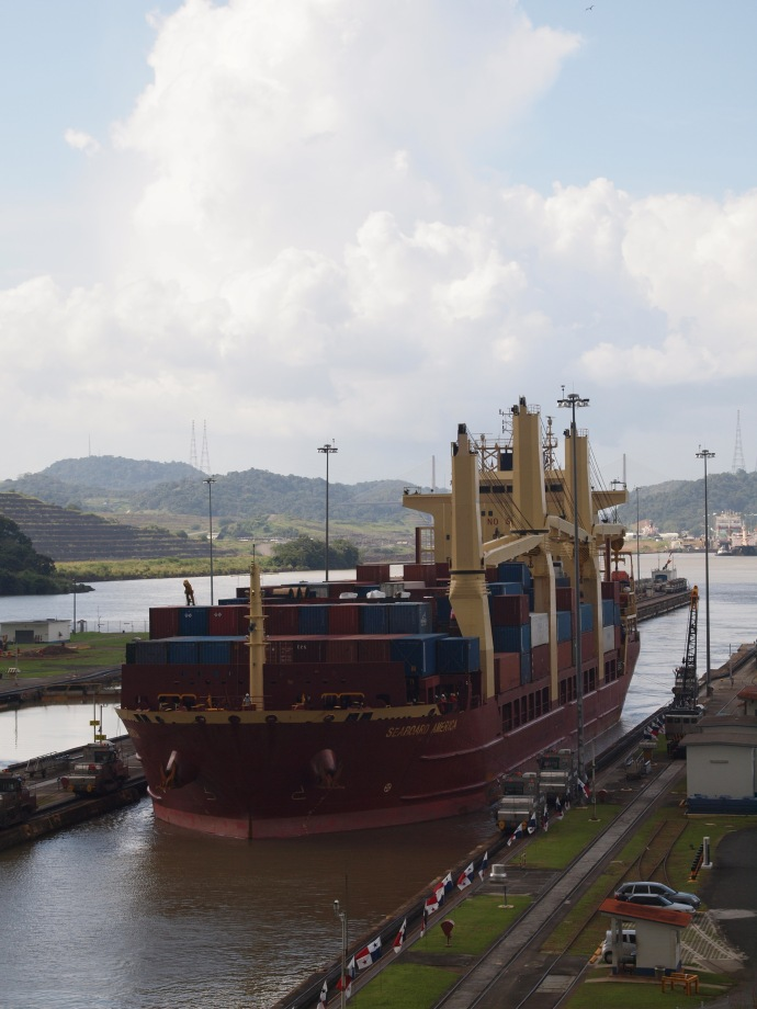 The container ship, with its colourful cargo, pulls into the Miraflores locks.