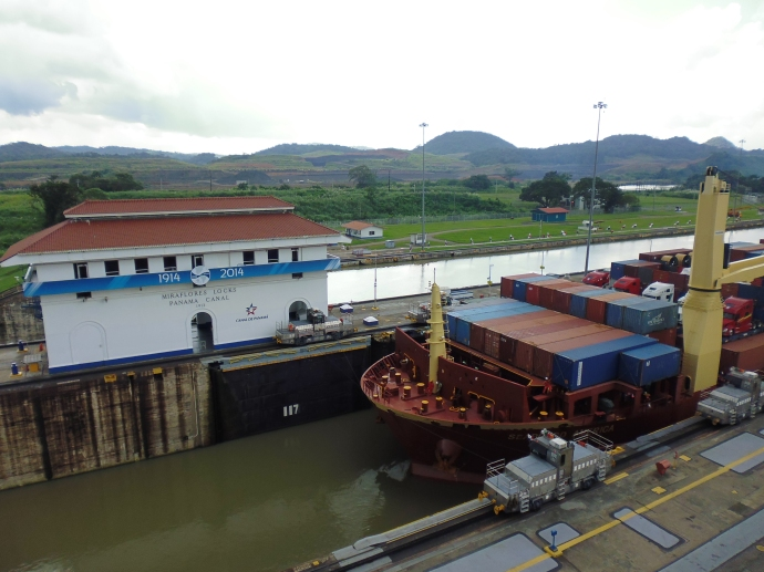 he container ship waits in one segment of the Miraflores Locks while the water level is lowered.