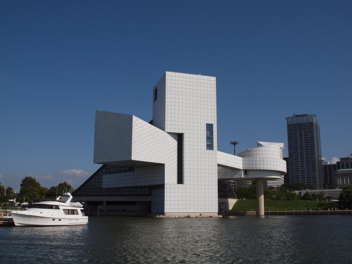 The Rock and Roll Hall of Fame and Museum, as seen from the harbour. The round section on the right of the building that juts out over the water is the Hall of Fame Gallery.
