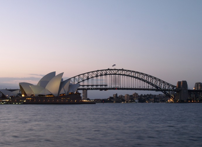 The Sydney Opera House and Harbour Bridge at dusk.