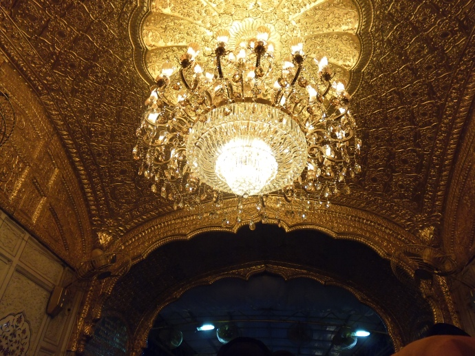 A gorgeous chandelier hangs at the entrance to the Hari Mandir.
