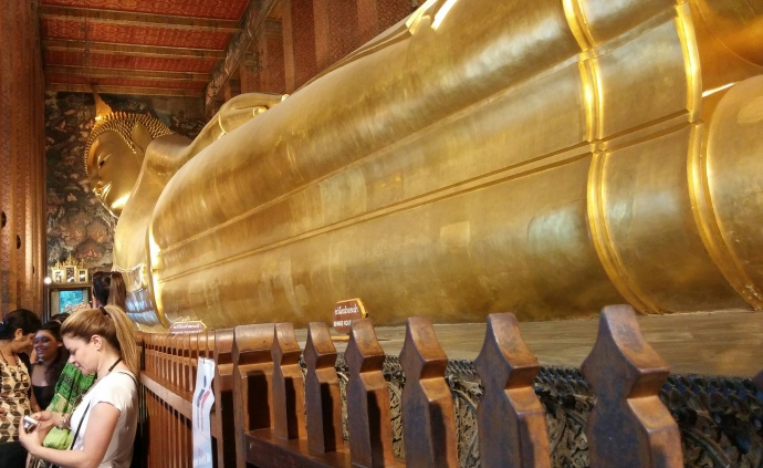 The Reclining Buddha at the Wat Pho temple in Bangkok is about 50 feet high and 150 feet long, and is covered in gold leaf.