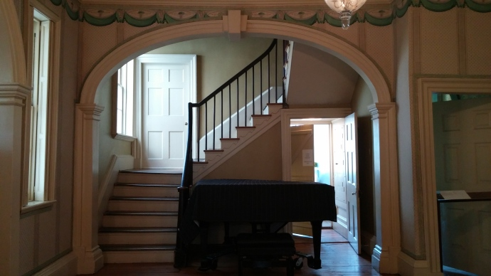 The staircase and hardwood floors that you see here are original. The piano was added much later, and is sometimes used for performances.
