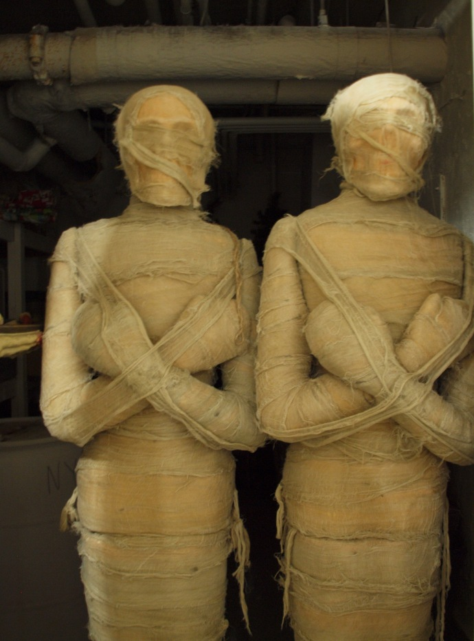 These mummies being stored in the basement are props for the hotel's annual Halloween celebration. OR ARE THEY???