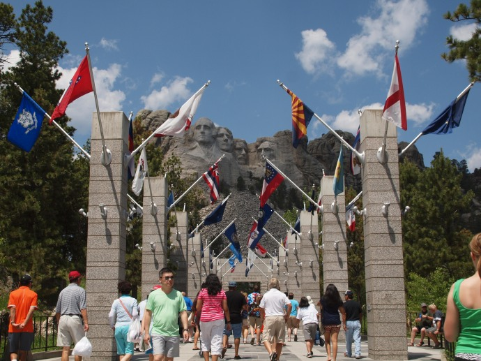 An avenue flanked by columns that display the flags of 56 U.S. states and territories.