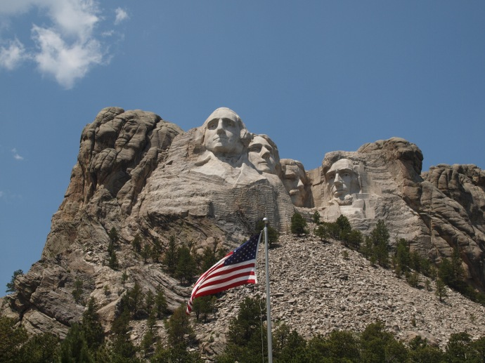 On July 4, an American flag flaps in the breeze, below the busts of four of the most storied American Presidents.