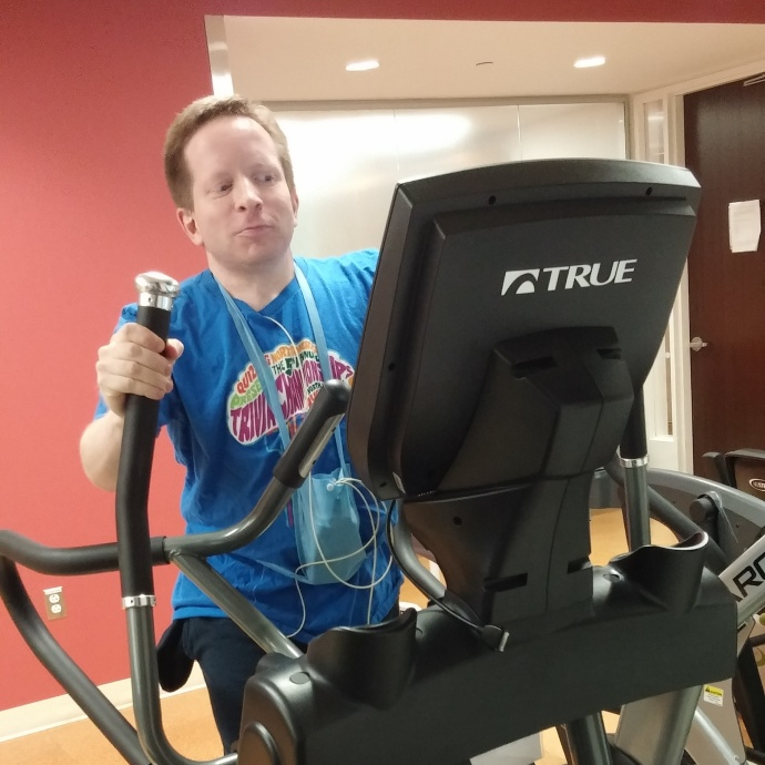 Me on an elliptical machine during one of my cardiac rehab sessions.