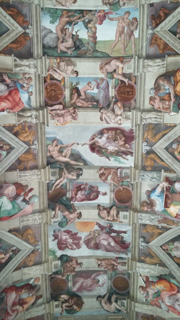 "A view of the Sistine Chapel ceiling in the Vatican Museums, featuring the iconic panel entitled ""The Creation of Adam."""