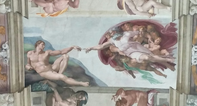 Detail of the Sistine Chapel ceiling, showing the Creation of Adam.