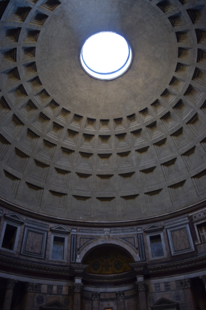 Looking up towards the oculus, a circular opening in the center of the dome that crowns the Pantheon.