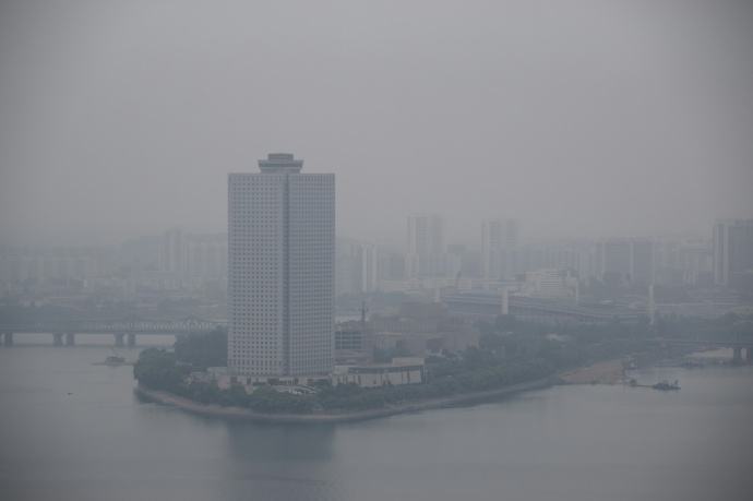 The Yanggakdo International Hotel on an overcast day, viewed from atop the Tower of the Juche Idea.