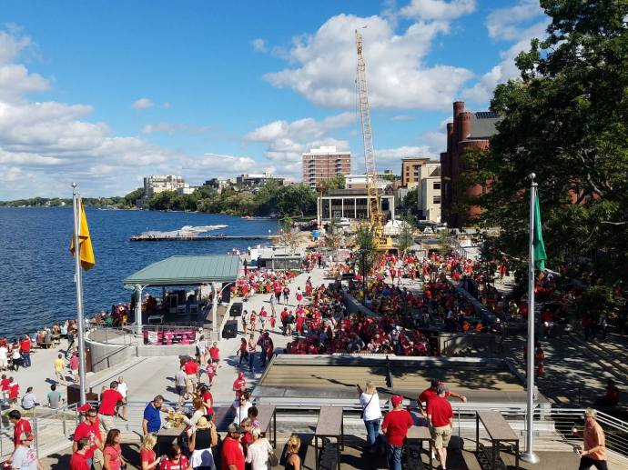 The Memorial Union Terrace, shortly after the conclusion of a football game on campus, is a sea of red.